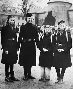 Royal Girl Scouts of Sweden: Princess Sibylla (second from left), was present when her three daughters, the Princesses Margaretha (left), Desiree (second from right), and Birgitta, (right) participated in the patrol competitions of the Girl Scouts of Stockholm, of which the princesses are members. May 9, 1948.