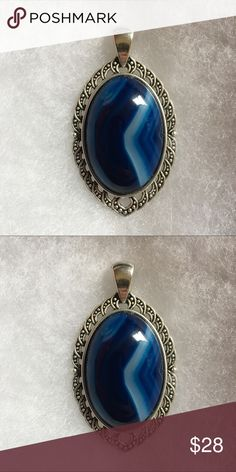 Blue Onyx Agate Pendant Blue Onyx agates are 30x20x7mm and the settings (pendant base) on each stone is made out of antique silver. As you can tell by the pictures, these stones are gorgeous! Jewelry Necklaces