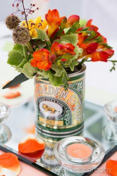 Flowers in retro golden syrup tin by The White Horse Flower Company.