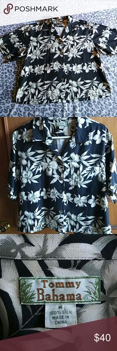 Tommy Bahama shirt Women's Tommy Bahama shirt. 100% silk. It's black with white and grey flowers. From the shoulder seam to the front bottom hem it measures 21 inches. The shirt has one front pocket and 4 buttons. Tommy Bahama Tops Button Down Shirts