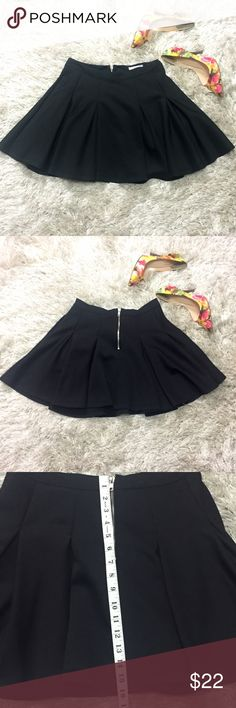 Black Skater Skirt Originally purchased from Nordstrom. Size medium. Worn once. Zipper detail in back. Pleated. Size pockets. 95% polyester. 5% elastane. Feel free to ask questions!  Glamorous Skirts