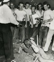 An officer stepped in after young white men attacked a young black man at Fairground Park in St. Louis in 1949. Deep roots of racial violence here.