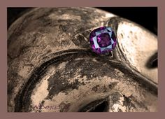 Wonderful forty carat Umbalite Garnet from Tanzania on old African Art. The color is superb and luster very brilliant.