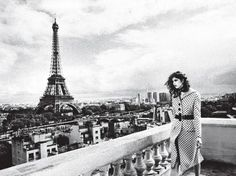 The view from The Shangri-La Hotel, Paris. Her coat, scarf, and belt by Miu Miu; ring by Bulgari.