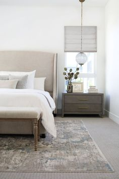 modern farmhouse bedroom design, neutral bedroom decor with upholstered headboard and white bedding with modern pillows, nightstand decor, nightstand styling with artwork over bed, neutral rug in master bedroom decor with bench at end of bed Neutral Bedroom Decor, Home Decor Bedroom, Bedroom Furniture, Bedroom Ideas, Furniture Ideas, Modern Furniture, Neutral Bedrooms, Furniture Market, Decor Room