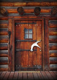 Door of rustic cabin, cottage or lodge.