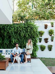 Vertical wall planters. Create something similar with these https://www.urbilis.com/outdoor-wall-planters/
