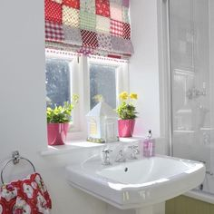 I like the colour coming from the blind against the clean white of the bathroom