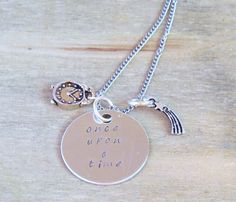 Once Upon A Time Necklace - Magic Story Fairy Tale Charm Hand Stamped Jewelry - Silver - Perfect for Fans of the TV Show - Under 25 Dollars. £12.00, via Etsy.