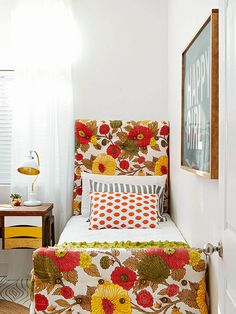 Vintage curtains make the bed's headboard stand out with fun colors and patterns: http://www.bhg.com/decorating/decorating-style/flea-market/house-tour--fresh-retro-style/?socsrc=bhgpin112514retroforkids&page=13