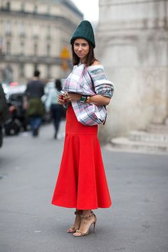 A beanie doesn't solely have to pair with sportier fashions. Add a dose of drama by pairing your beanie with an elegant skirt and a pair of strappy sandals.    - HarpersBAZAAR.com