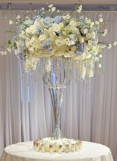 Tall, ivory and light blue centerpiece.