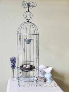 wire bird cage with nest. pretty! (Disclaimer: I do not own this image. Click on photo to find the site it was pinned from.)