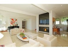 We love the contrast of this fireplace to its all white surroundings in this living room.  911 Tione Rd Los Angeles, CA
