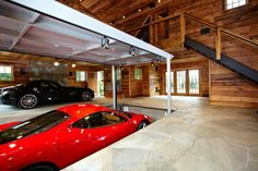 The garage at the log cabin, Josef's Hummer sits to the right of the red car...the floor is sloped so snow and rain drains out of the garage naturally! Gotta love Houzz.com, it sets dreams free!