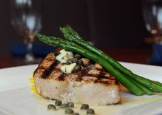 Grilled swordfish with lemon caper butter, asparagus, and saffron risotto from the River Grille in Easton.