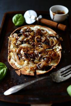 Simple but flavorful pizza with goat cheese, caramelized onion and balsamic drizzle that takes less than 30 minutes from start to finish.