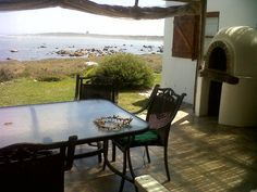 Tern Beach House - Tern Beach House offers self-catering accommodation in Jacobs Bay, situated midway between Vredenburg and Saldanha Bay, a traditional Cape West Coast village. This preserved and beautiful stretch of coastline . Outdoor Tables, Outdoor Decor, Weekend Getaways, West Coast, Catering, Beach House, Cape, Patio, Outdoor Furniture
