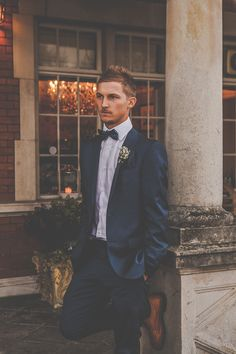 A Beautiful Winter Wedding at Eaves Hall. Groom wearing navy suit.  Image by Sally Eaves Weddings.  Read more: http://bridesupnorth.com/2017/04/19/cool-yule-a-beautiful-winter-wedding-at-eaves-hall-sally-chris/  #wedding