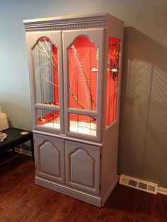 My aviary made from a repurposed armoire