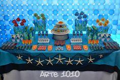 Esta festa foi comemorada no fundo do mar! Com direito a muitos peixes e outros seres marinhos... ... como tartarugas, po...