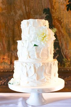 Simple white wedding cake // Photo by http://amalieorrangephotography.com, via http://theeverylastdetail.com/classic-ivory-florida-wedding-southwestern