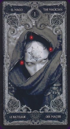 I-Magician from The XIII Tarot, very literally a dark deck; illustrated in greys and blacks with highlights in red. The artwork on the major arcana is a little gothic and a little Giger-esque, while the minor arcana have simple arranged pips without scenes. #tarot