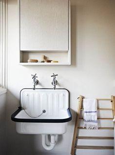 A tiled bathroom has an industrial feel.