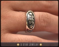 Sterling Silver Bahai Ring with ring stone symbol.  Dimensions : Top Width = 8mm  As seen in the Bahai House of worship bookstore in Wilmette, Illinois.
