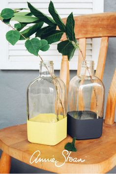 Glass bottles painted using Annie Sloan Chalk Paint - graphite and English Yellow were the colours used