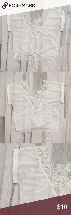 """Charlotte Russe Boho Sheer Top Charlotte Russe Boho Sheer Top. EUC. Textured Swiss dot pattern, lace neckline, ties at waist. Size: M. Bust: 32"""", length: 19"""". 100% polyester. Hand wash. Charlotte Russe Tops Blouses"""