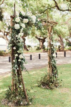 Rustic-romantic wedding ceremony, wedding arbor ideas, cream florals, branches // Rachel Red Photography