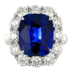 7.15 Carat No Heat Sapphire Diamond Ring | From a unique collection of vintage cluster rings at https://www.1stdibs.com/jewelry/rings/cluster-rings/