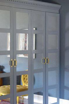 Ikea hack - mirror tiles, crown molding, and door pulls added to wardrobe