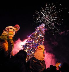 People gather in front of the 30-metre high tree during the lighting ceremony in central Sofia, Bulgaria.