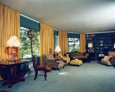 View of Senator Margaret Chase Smith's living room.  The expansive windows overlook the Kennebec River.