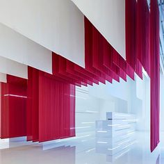 Layers of red fabric that reference traditional Chinese archways are draped inside Beijing's @BMW Museum by @Crossboundaries_Beijing. : Yang Chao Ying. @sandow