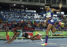 Bahamas' Shaunae Miller falls over the finish line to win gold ahead of United States' Allyson Felix, right, in the women's 400-meter final during the track and field competitions of the 2016 Summer Olympics at the Olympic stadium in Rio de Janeiro, Brazil, on August 15.