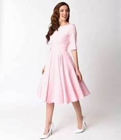 You'll have their hearts pumping, darling! This super elegant pink Hepburn Dress from The Pretty Dress Company is a stunning Pin-up 1950s inspired piece. Featuring a vintage style, darted bodice with a sleeved silhouette framing the lovely round neckline,