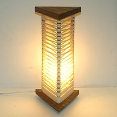 This wood and string lamp is fun to make, and you can arrange the string into so many different variations for a lamp that is truly unique.