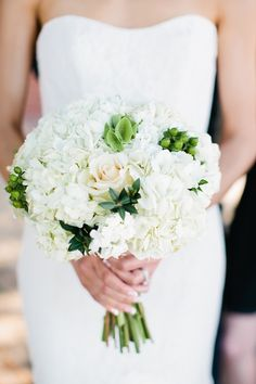 White bouquet with pops of green
