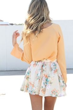 The orange flowers in the skirt go so great with the matching shirt!  It's so flowy and big it will definitely keep you cool in the summer!