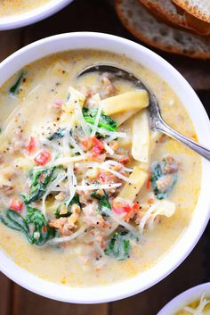 Italian Sausage Soup recipe for a creamy, comforting soup with noodles that is full of flavor and perfect for a family dinner during the cold winter months!