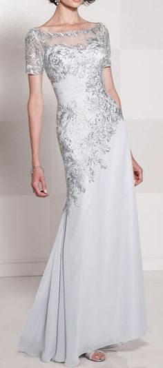 Cameron Blake. Love the detail. Take off the sleeves and just leave it as a sweetheart dress it'd be even better