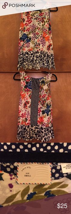 Pretty floral Anthropologie blouse Light, flowy, knit floral tank from Anthropologie. Perfect Spring/Summer top to wear with jeans or leggings. Slightly lower in the back than the front (about 2 inches). Pretty polka dot and bow detail on the back. Anthropologie Tops Blouses