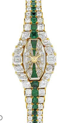 PIAGET. A LADY'S MAGNIFICENT AND RARE 18K GOLD, DIAMOND AND EMERALD-SET BRACELET WATCH