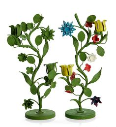 CANDLESTICKS, 2 pieces, Svenskt Tenn, green painted sheet of metal, one with colored flowers in yellow, blue, red and white, one of them paper labeled 19 pieces as this one, 55 white ones, 19 green ones, height 34 cm