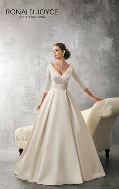 ANDREA A BEAUTIFULLY DESIGNED SATIN RUCHED BODICE WITH THREE QUARTER LENGTH SLEEVES, DEEP V BACK AND WIDE WAISTBAND ON A SOFT PLEATED BALL GOWN SKIRT