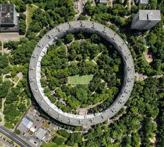 In the early Russian architect Evgeny Stamo and engineer Alexander Markelov came up with plans for an unusual house in the capital ci. Circular Buildings, Unusual Buildings, Interesting Buildings, Modern Buildings, Beautiful Buildings, Russian Architecture, Futuristic Architecture, Residential Architecture, Landscape Architecture