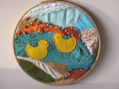 Embroidery hoop fibre art fabric collage, two yellow ducks swimming in a pond on a crazy quilt background  by LIGONaccessories, $32.50